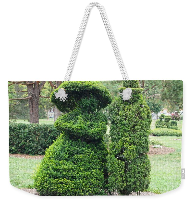 Topiary Couple Weekender Tote Bag featuring the photograph Topiary Couple by Dan Sproul