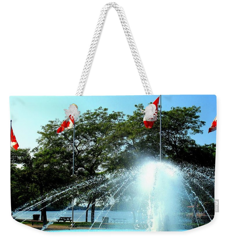 Toronto Weekender Tote Bag featuring the photograph Toronto Island Fountain by Ian MacDonald