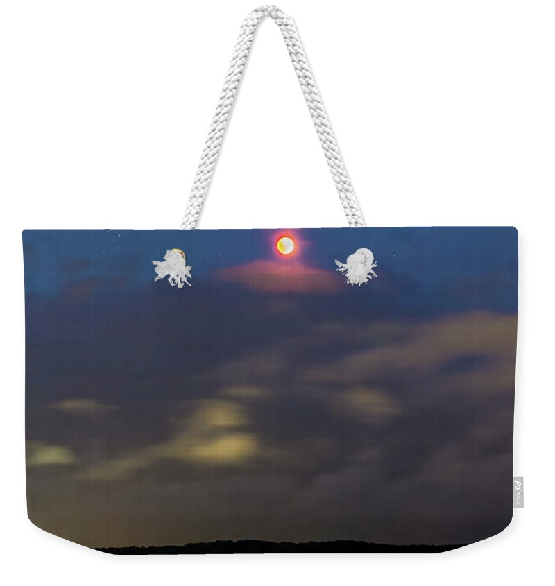 April 15 2014 Weekender Tote Bag featuring the photograph Total Lunar Eclipse From Australia by Alan Dyer