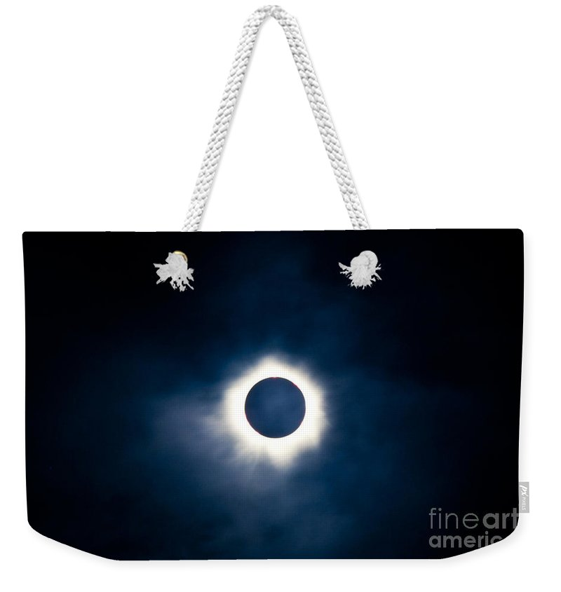 Astronomical Weekender Tote Bag featuring the photograph Total Solar Eclipse With Visible Corona by Stephan Pietzko