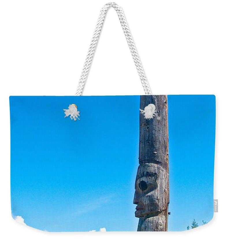 Totem Pole In Gitwangak Weekender Tote Bag featuring the photograph Totem Pole In Gitwangak-bc by Ruth Hager