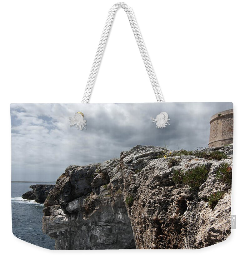Architecture Weekender Tote Bag featuring the photograph Stunning Tower Over The Cliffs Of Alcafar In Minorca Island - Tower And Sea by Pedro Cardona Llambias