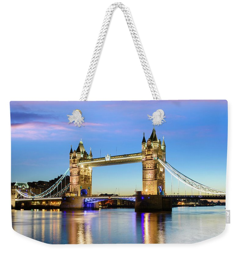Downtown District Weekender Tote Bag featuring the photograph Tower Bridge Located In London by Deejpilot
