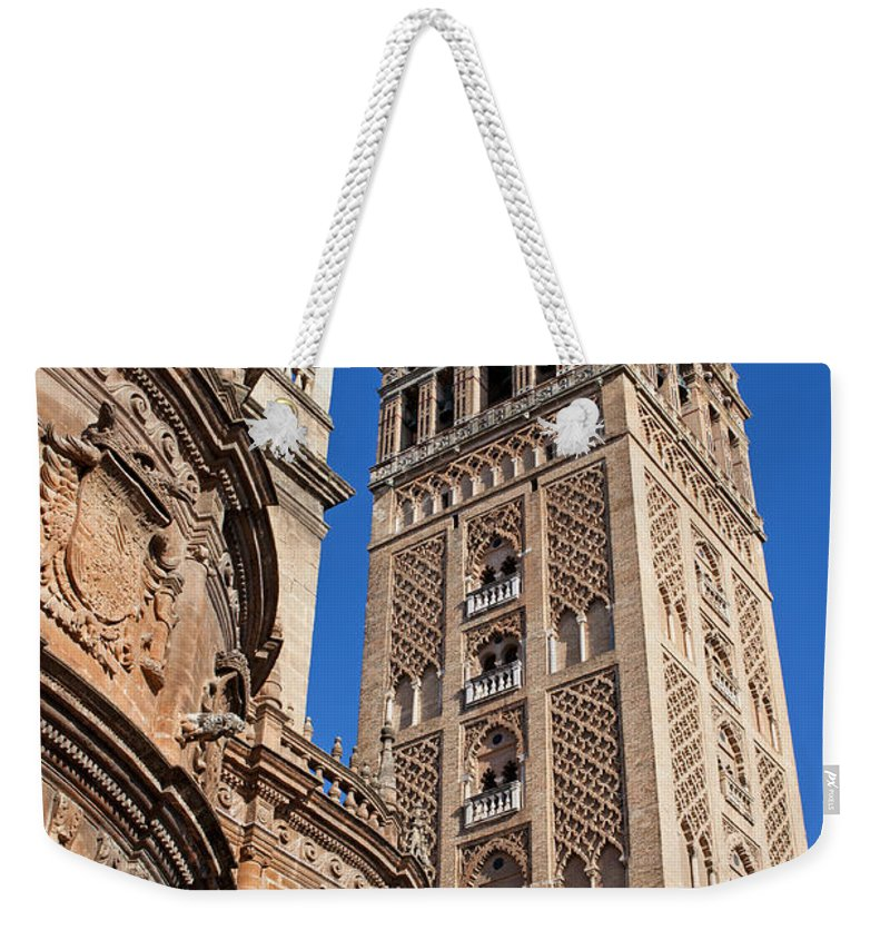 Almohad Weekender Tote Bag featuring the photograph Tower Of The Seville Cathedral by Artur Bogacki