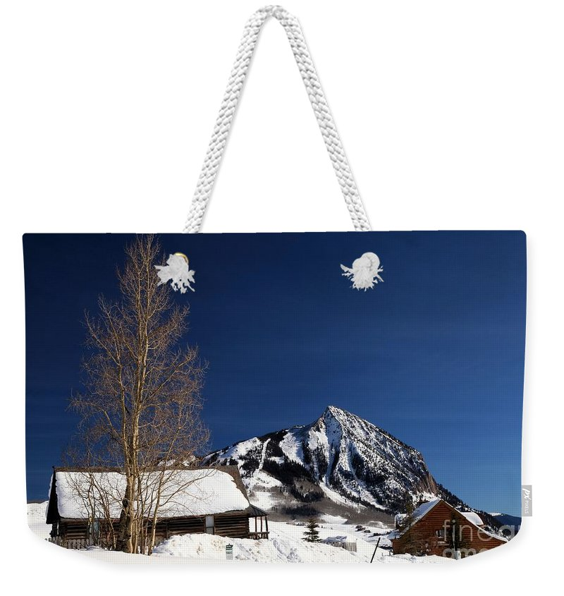Crested Butte Weekender Tote Bag featuring the photograph Towering Above Crested Butte by Adam Jewell