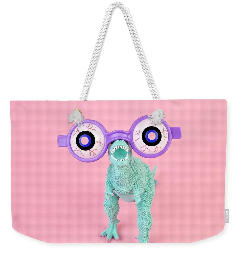 Purple Weekender Tote Bag featuring the photograph Toy Dinosaur With Spooky Glasses by Juj Winn
