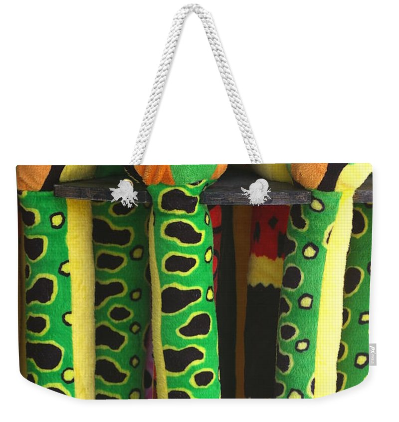 Toys Weekender Tote Bag featuring the photograph Toy Snakes by Randy Pollard