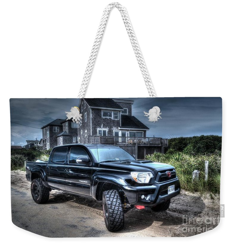 A Brand New Toyota Tacoma Trd Off Road Truck Parked In Front Of Some Beach Houses. Toyota Tacoma Weekender Tote Bag featuring the photograph Toyota Tacoma Trd Truck by Robert Loe
