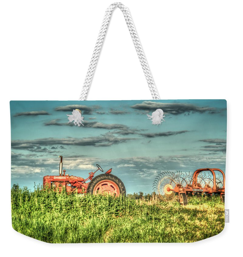 Tractor Weekender Tote Bag featuring the photograph Tractor And Hay Rake by Douglas Barnett