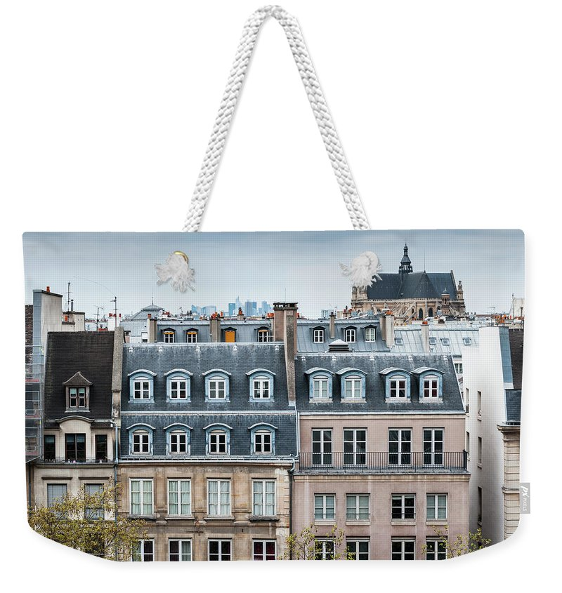Built Structure Weekender Tote Bag featuring the photograph Traditional Buildings In Paris by Mmac72