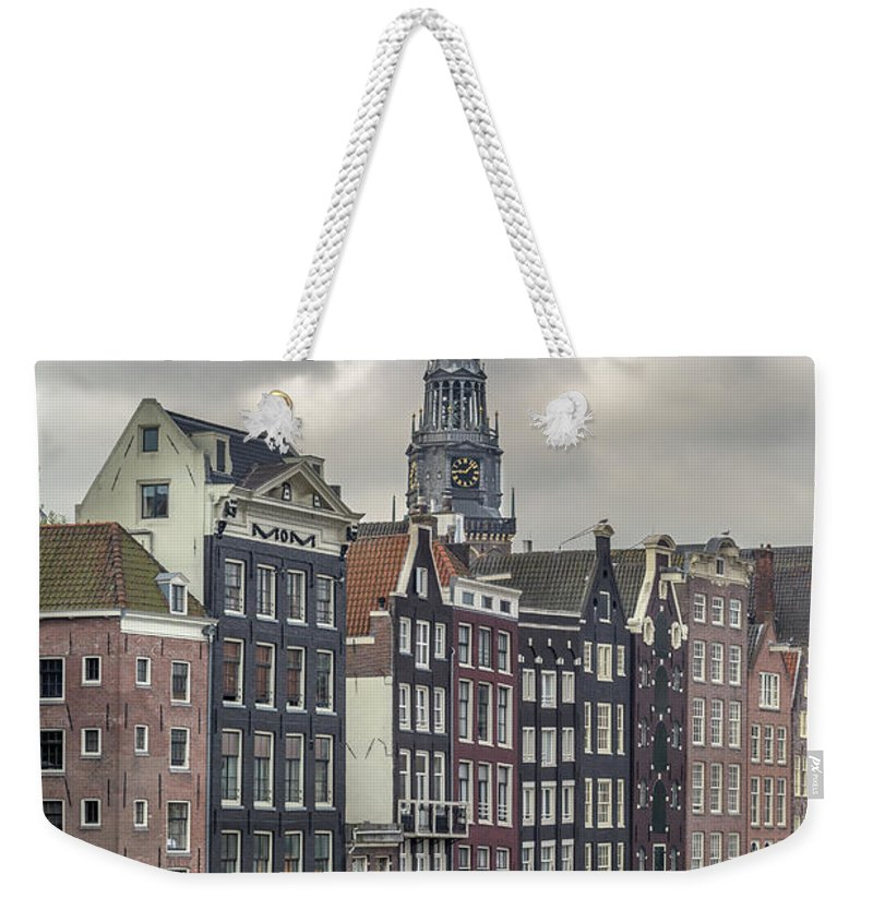 In A Row Weekender Tote Bag featuring the photograph Traditional Dutch Houses Over A Canal by Buena Vista Images