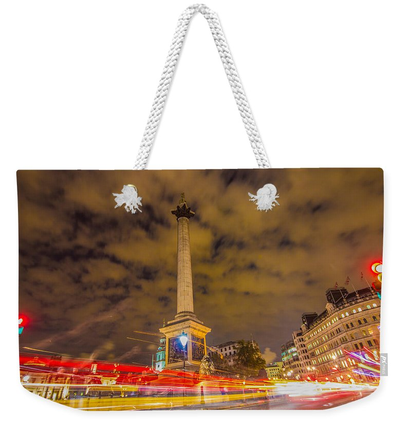 London Weekender Tote Bag featuring the photograph Trafalgar Light Trails by Dawn OConnor