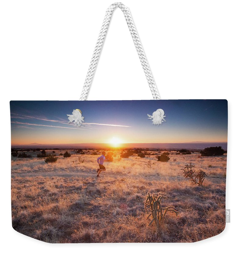 Scenics Weekender Tote Bag featuring the photograph Trail Running by Amygdala imagery