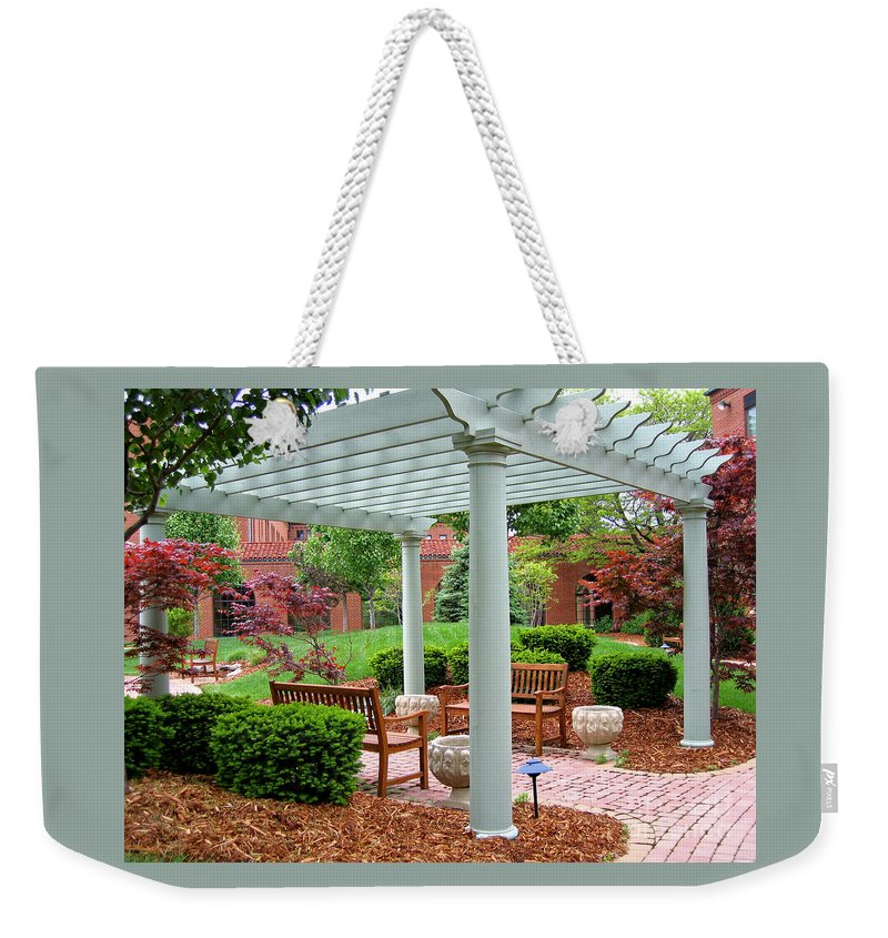 Courtyard Weekender Tote Bag featuring the photograph Tranquil Courtyard by Ann Horn