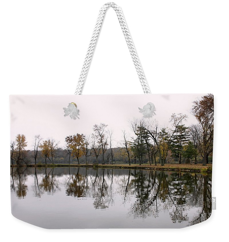 Lake Weekender Tote Bag featuring the photograph Tranquil Reflections by Ely Arsha