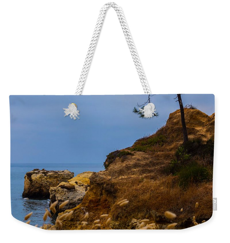 Albufeira Weekender Tote Bag featuring the photograph Tree On A Cliff II by Marco Oliveira