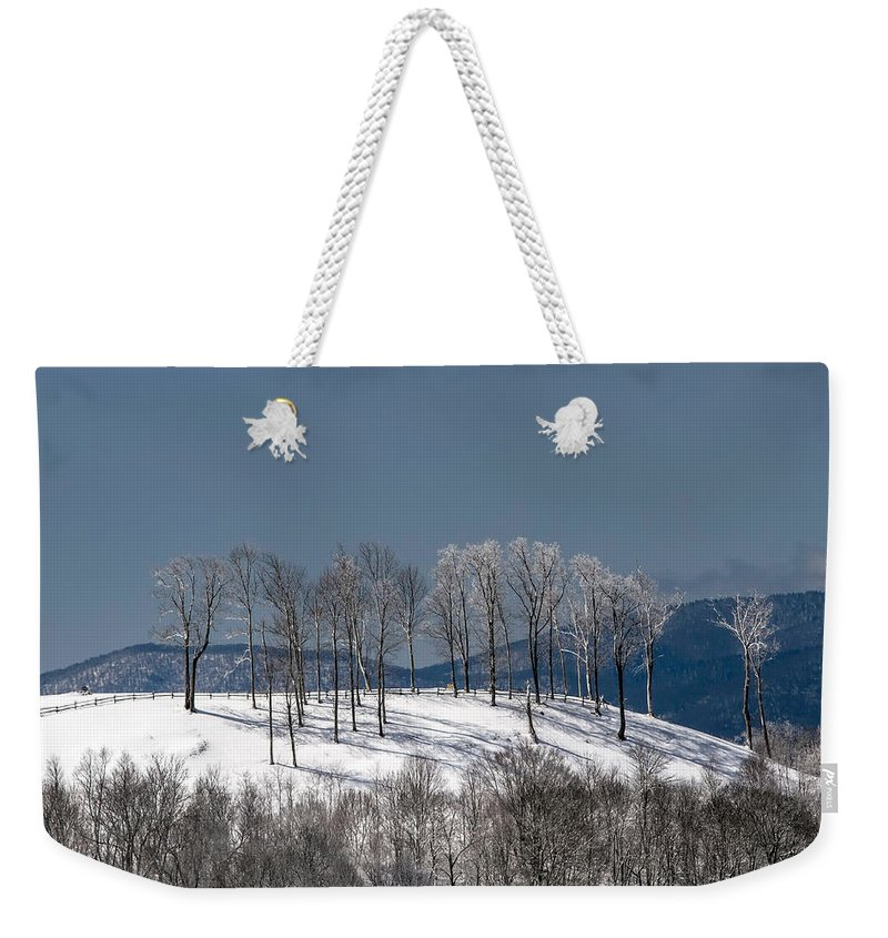 Snow Weekender Tote Bag featuring the photograph Tree Topper Hill by John Haldane
