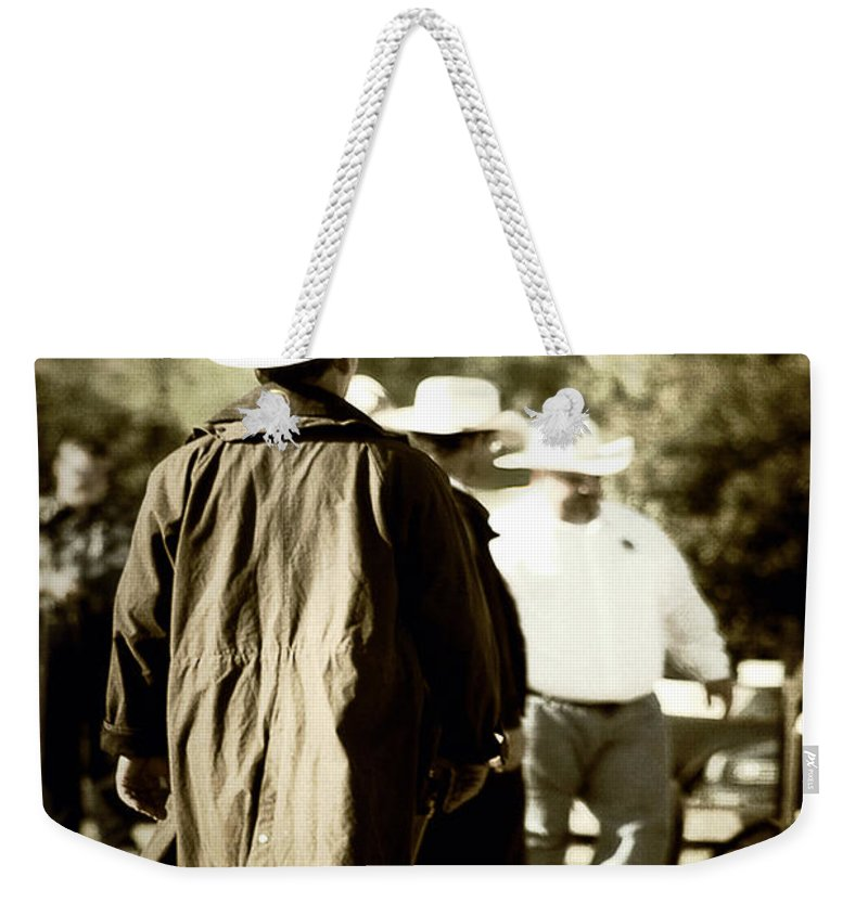 Country Weekender Tote Bag featuring the photograph Trenchcoat Cowboy by Trish Mistric