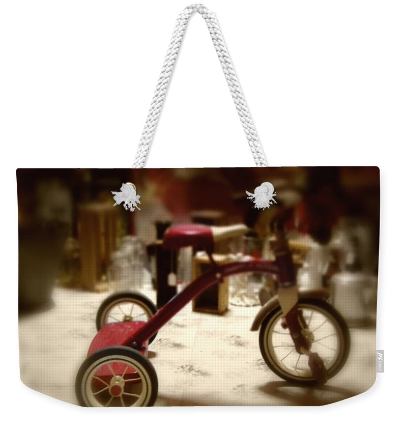 Antique; Childhood; Toy; Tricycle; Bike; Radio Flyer; Heirloom; Nostalgia; Old; Retro; Vintage; Miniature; Lighting; Dark; Darkness; Shadows; Eerie; Creepy; Lost Weekender Tote Bag featuring the photograph Trike by Margie Hurwich