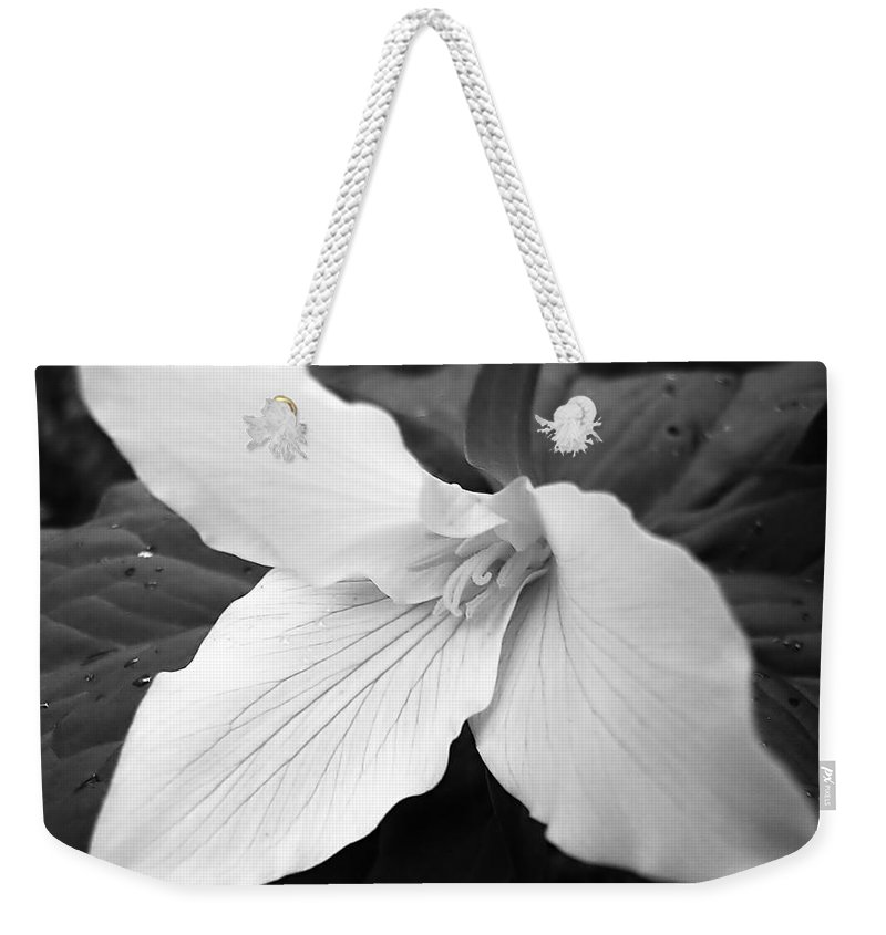 Trillium Weekender Tote Bag featuring the photograph Trillium Flower In Black And White by Jennie Marie Schell