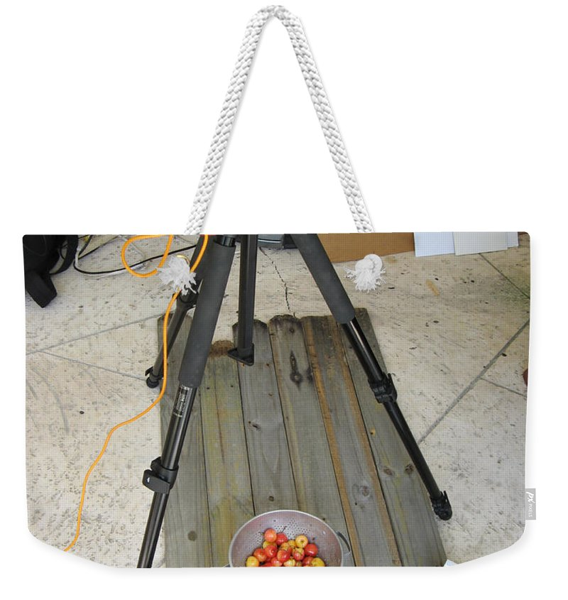 Cherries Weekender Tote Bag featuring the photograph Tripod And Cherries On Floor by Rich Franco