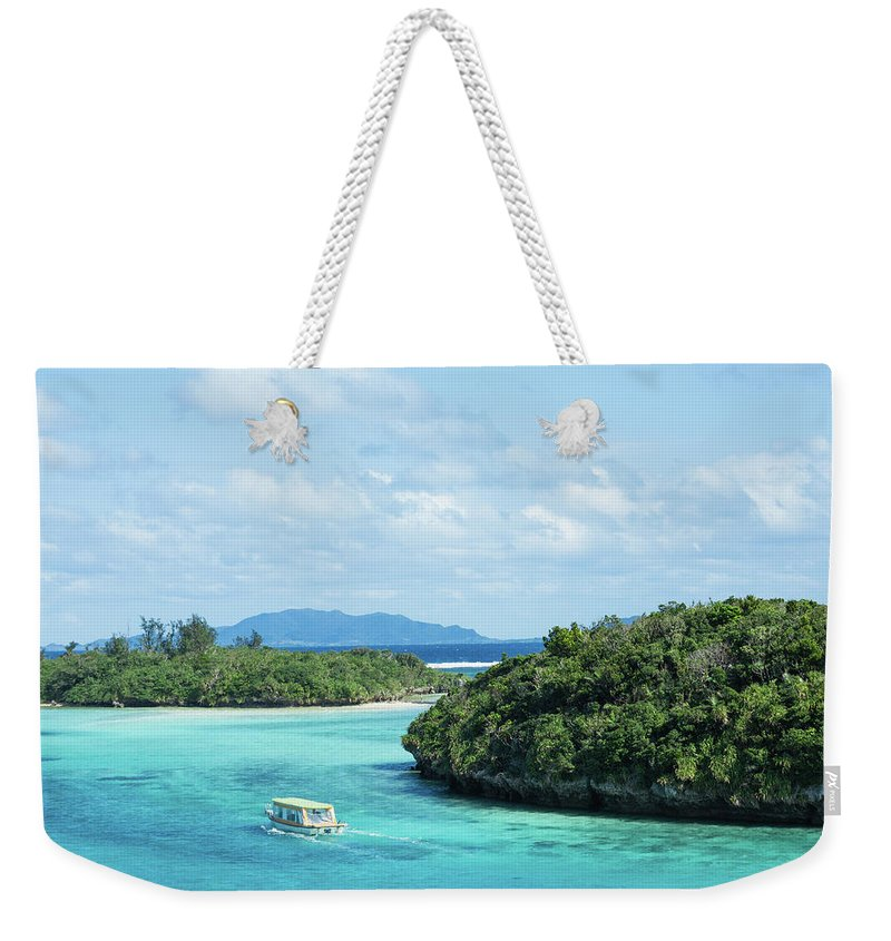 Outdoors Weekender Tote Bag featuring the photograph Tropical Blue Lagoon And Lush Rock by Ippei Naoi