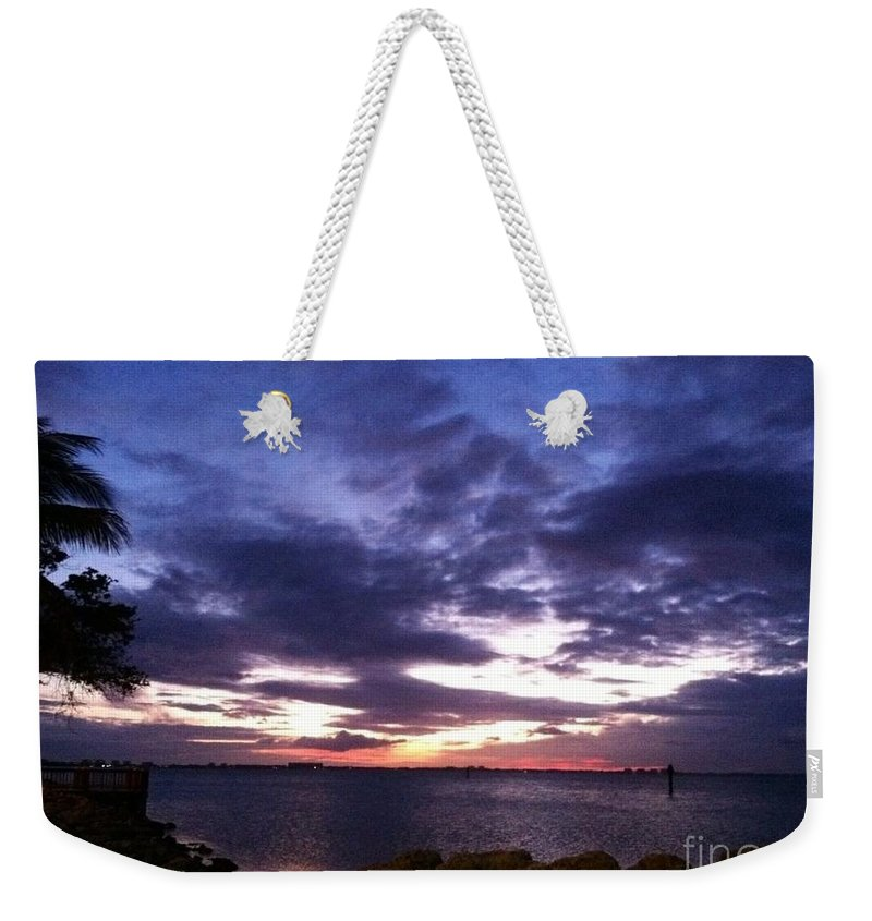 Sand Weekender Tote Bag featuring the photograph True Blue Sunset by Melissa Darnell Glowacki