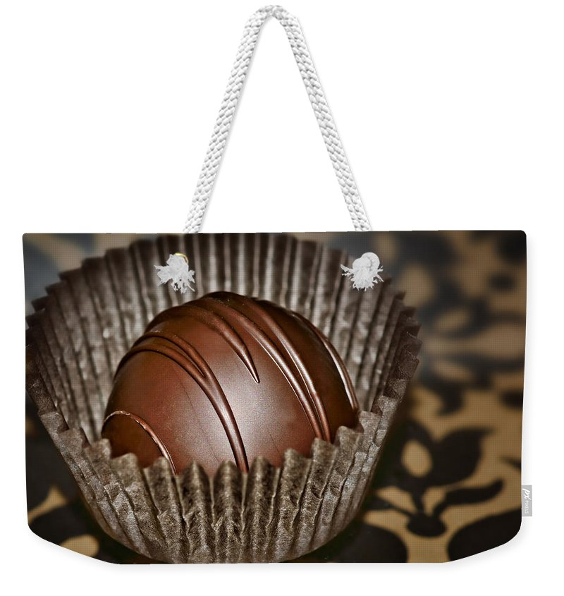 Chocolates Weekender Tote Bag featuring the photograph Truffle by Nikolyn McDonald