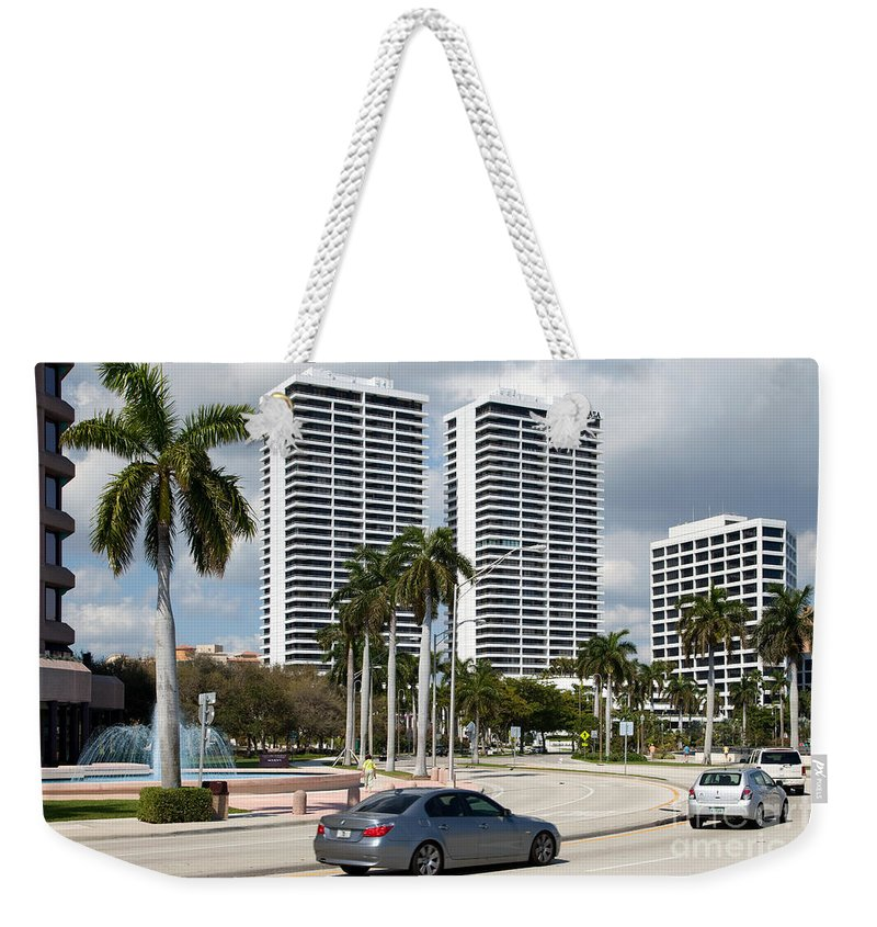 Florida Weekender Tote Bag featuring the photograph Trump Plaza In Downtown West Palm Beach Skyline by Bill Cobb