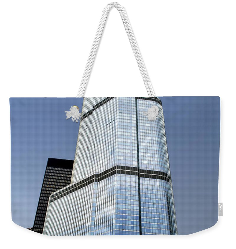 Chicago Weekender Tote Bag featuring the photograph Trump Tower Facade 3 Letter Signage by Thomas Woolworth