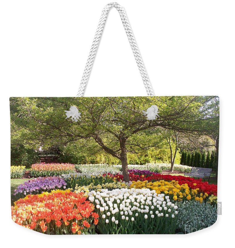 Tulip Weekender Tote Bag featuring the photograph Tulip Garden by Eric Schiabor