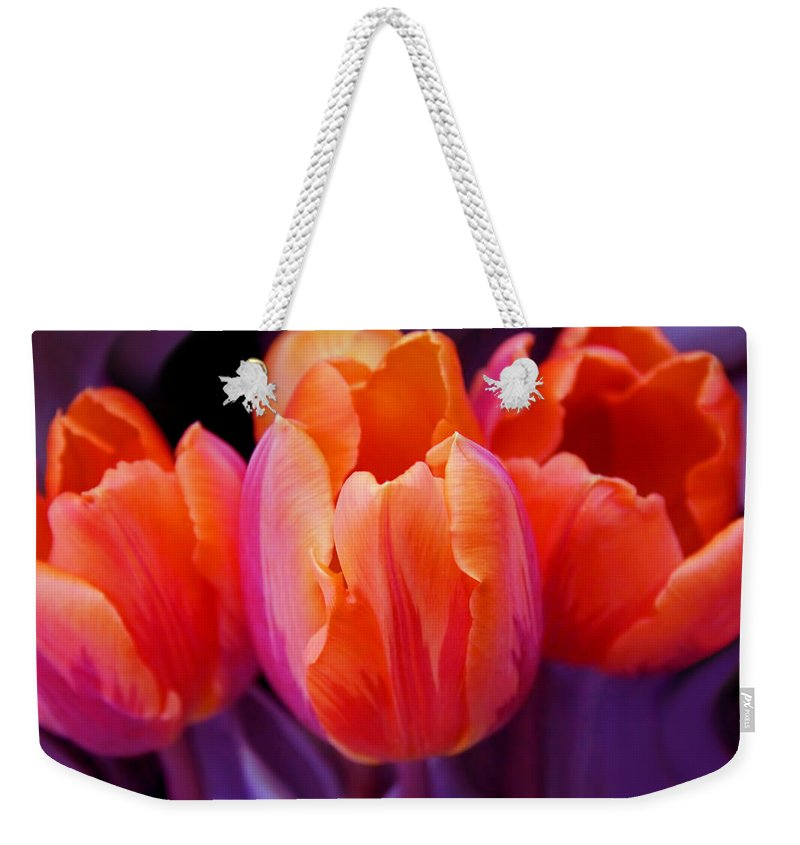 Tulip Weekender Tote Bag featuring the photograph Tulips In Orange And Purple by Jennie Marie Schell