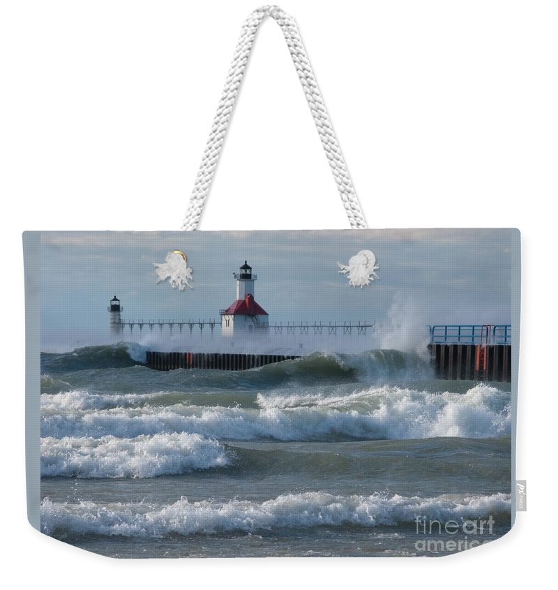 Wind Weekender Tote Bag featuring the photograph Tumultuous Lake by Ann Horn