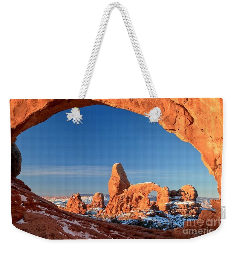 Turret Arch Weekender Tote Bag featuring the photograph Turret In A Window by Adam Jewell