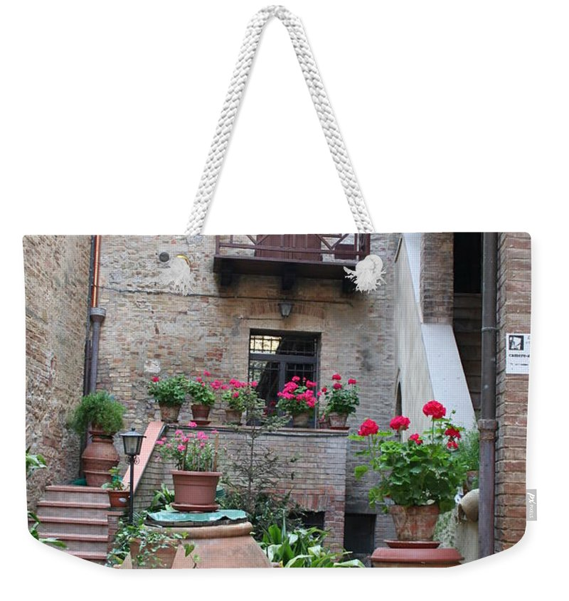 Yard Weekender Tote Bag featuring the photograph Tuscany Yard by Christiane Schulze Art And Photography