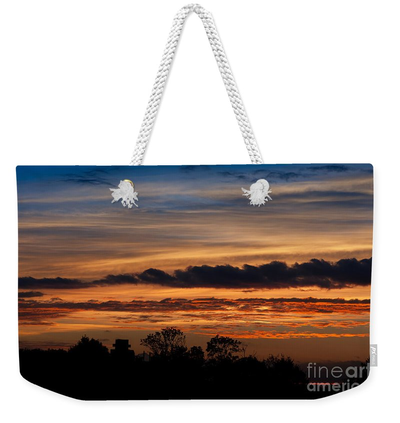 Air Weekender Tote Bag featuring the photograph Twilight Colorful Sunset by Arletta Cwalina
