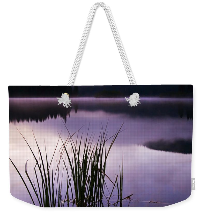 Lake Weekender Tote Bag featuring the photograph Twilight Glow by Mike Dawson