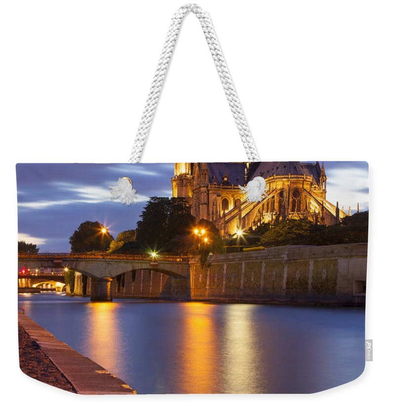 Architectural Weekender Tote Bag featuring the photograph Twilight Over Notre Dame by Brian Jannsen