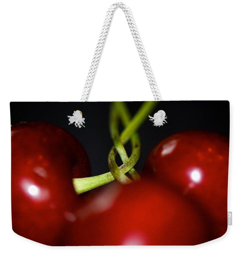 Cherries Weekender Tote Bag featuring the photograph Twisted Cherries by Lisa Knechtel