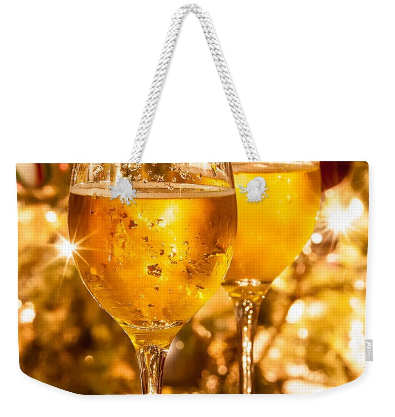 Alcohol Weekender Tote Bag featuring the photograph Two Champagne Glasses Ready To Bring In The New Year by Alex Grichenko