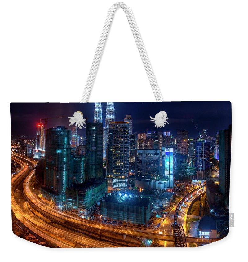 Outdoors Weekender Tote Bag featuring the photograph Two Direction In Klcc by Rithauddin Photographer