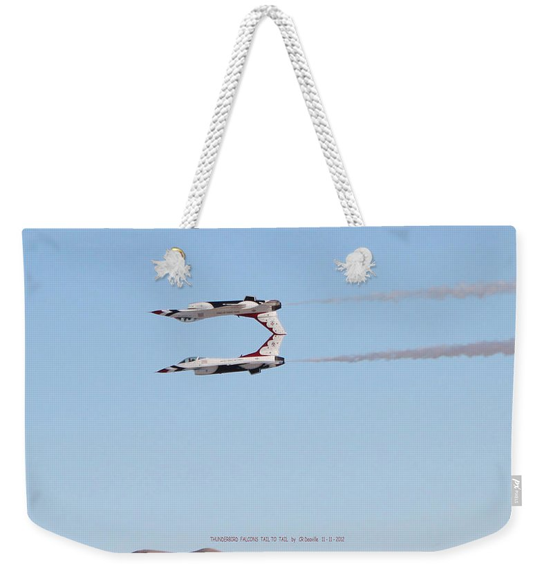 F16s Weekender Tote Bag featuring the photograph Two F-16 Thunderbird Falcons Flying Tail To Tail by Carl Deaville
