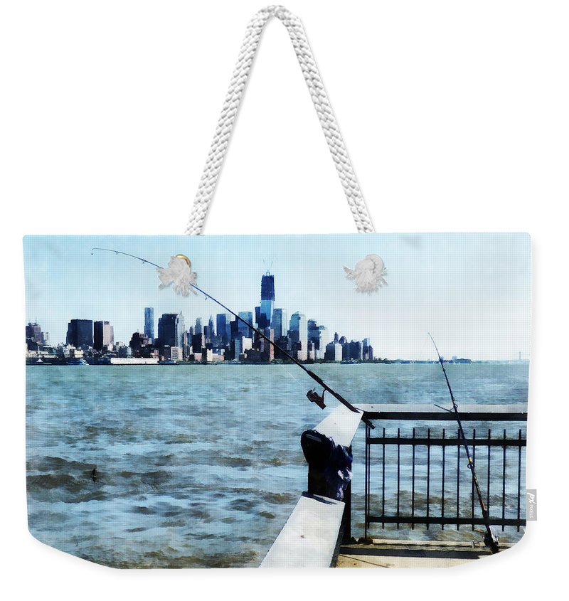 Fisherman Weekender Tote Bag featuring the photograph Two Fishing Poles by Susan Savad