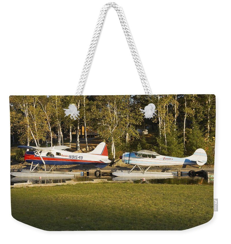 Airplane Weekender Tote Bag featuring the photograph Two Float Planes On Moosehead Lake Near Greenville Maine by Keith Webber Jr