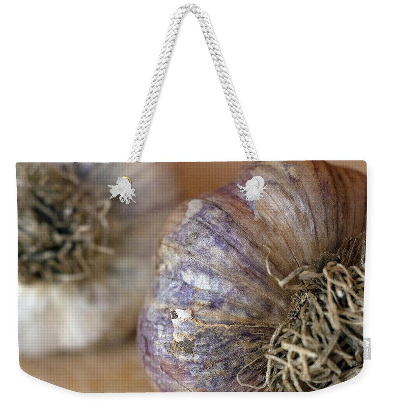 Garlic Weekender Tote Bag featuring the photograph Two Garlic Heads, Close-up by Rebecca E Marvil