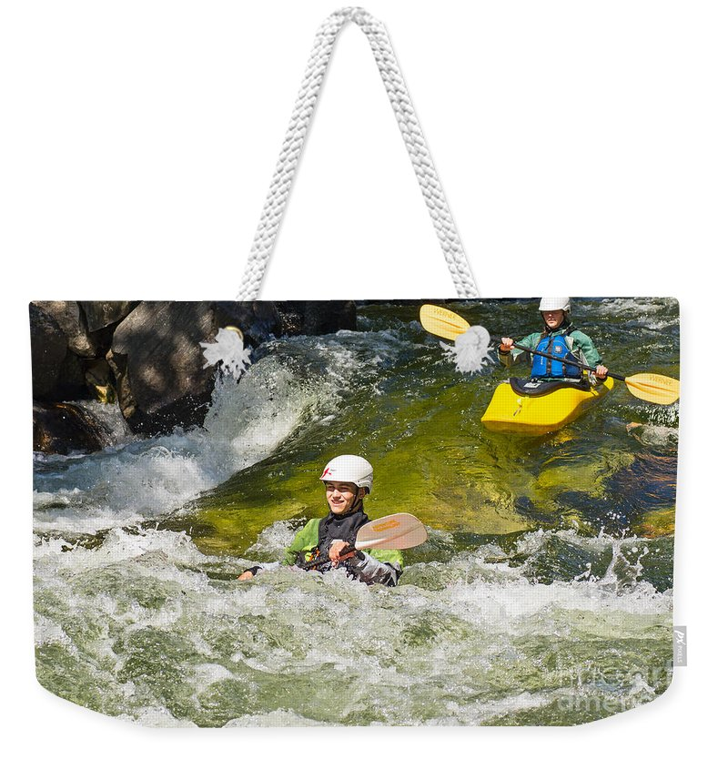 Kayak Weekender Tote Bag featuring the photograph Two Kayakers On A Fast River by Les Palenik