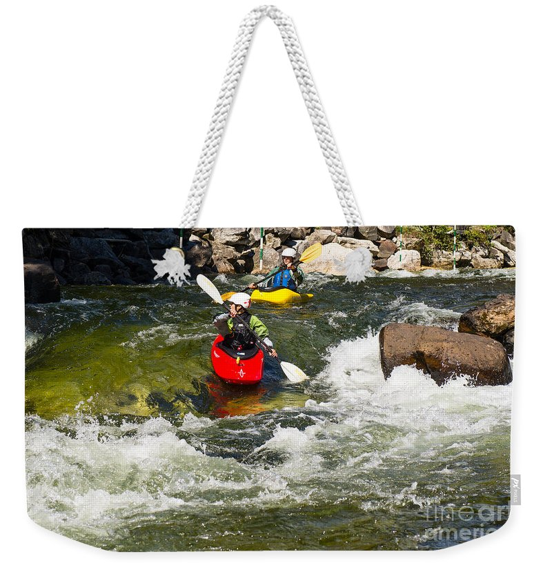 Kayak Weekender Tote Bag featuring the photograph Two Kayakers On A Whitewater Course by Les Palenik