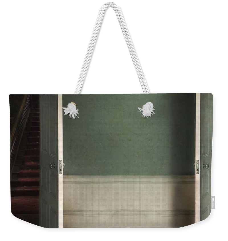 Doors Weekender Tote Bag featuring the photograph Two Open Doors In An Eerie Creepy House Leading To A Red Stairca by Lee Avison