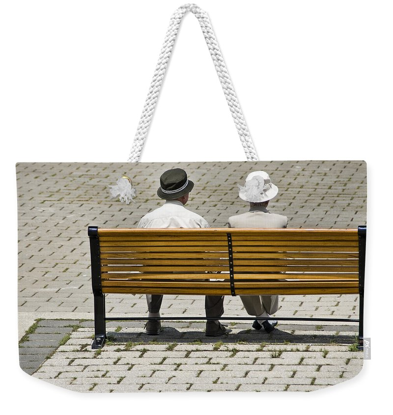 Art Weekender Tote Bag featuring the photograph Two People Seated On A Bench by Randall Nyhof