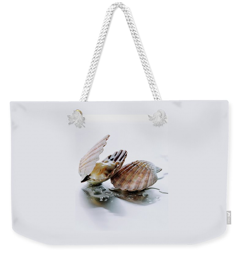 Cooking Weekender Tote Bag featuring the photograph Two Scallops by Romulo Yanes